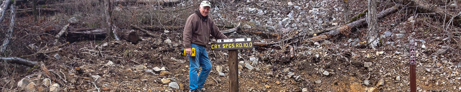 Jerry planting a new sign at the Brady Mountain entrance to the Bear Mountain trail segment